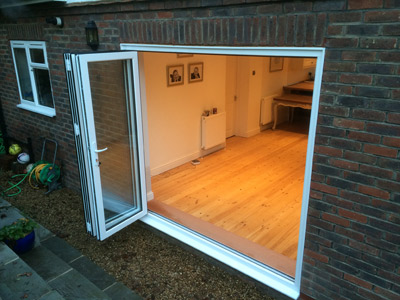 Fitting bifold doors to your home in Redhill can add so much more light and space